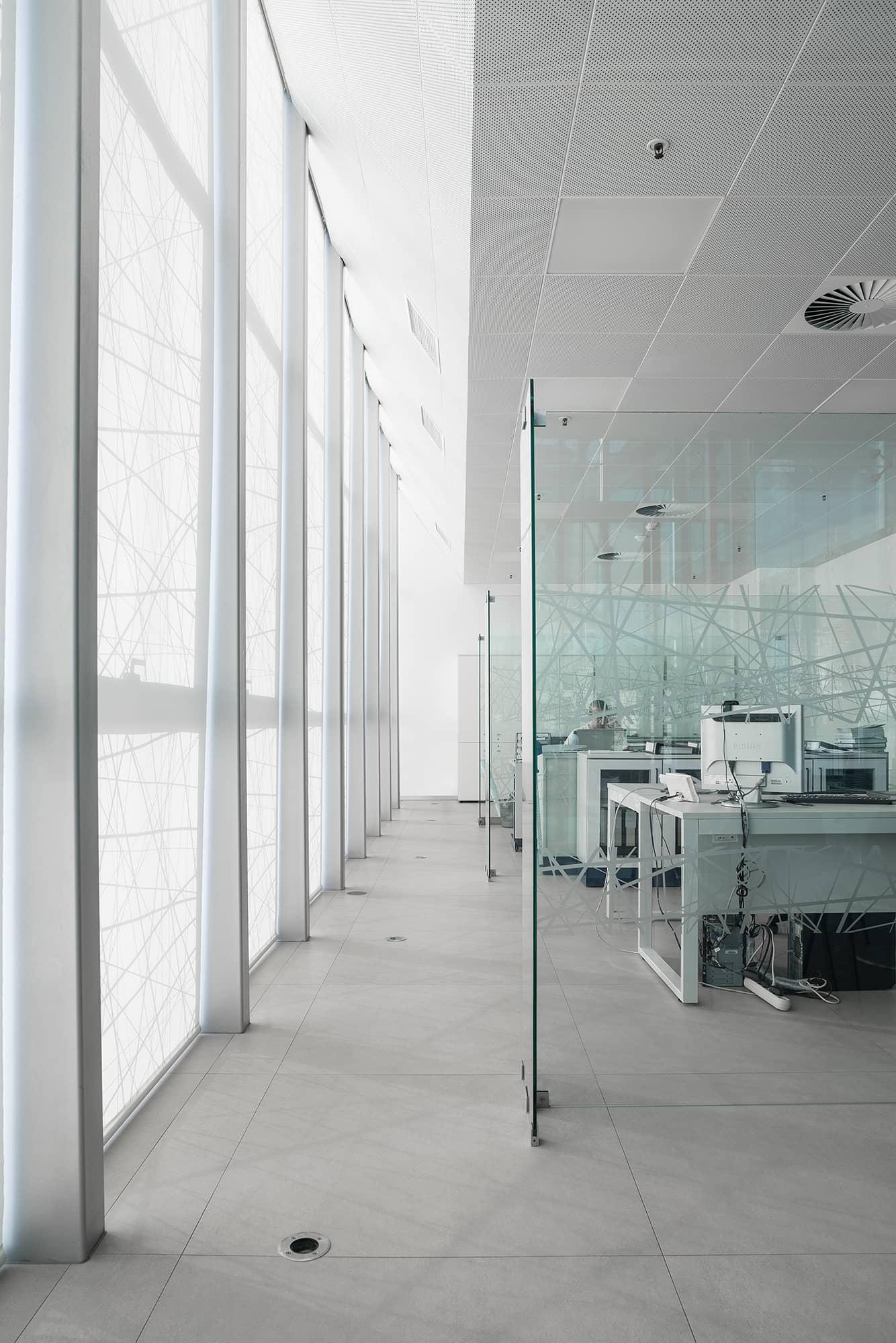 Respol office with Kerlite Over floors tiles.