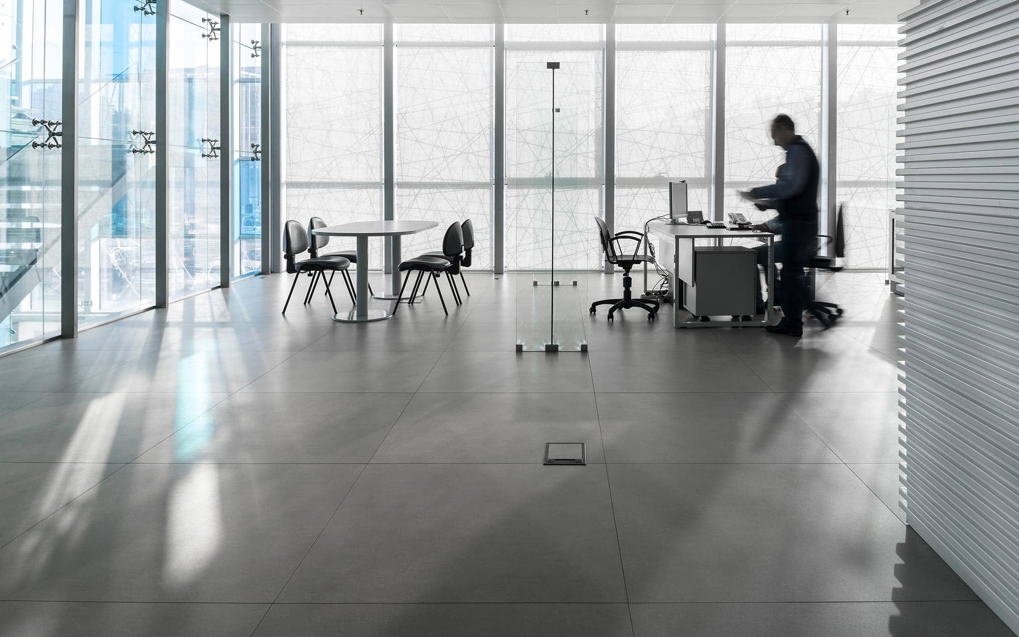 Meeting room of Respol with Kerlite Over floor tiles